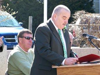 man speaking at a podium