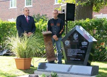 men next to a gravestone